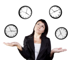 A young woman juggling the management of time. Isolated on a white background.